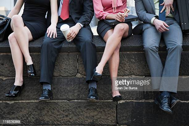office workers spending a lunch break outdoors. - legs crossed at ankle stock pictures, royalty-free photos & images