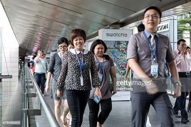 Office workers walk along a footbridge during lunch hour in Kuala Lumpur, Malaysia, on Tuesday, March 18, 2014. Malaysia, aspiring to become a...