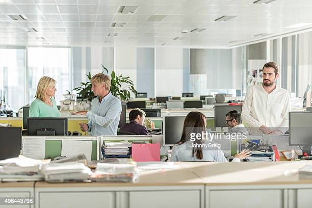 Office workers working in modern office with computers