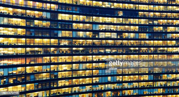 Office workers working late in major office building