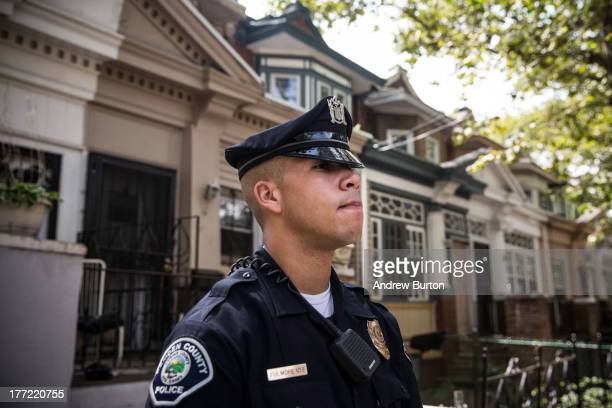 Officer Adam Fulmore, of the Camden County Police Department, goes on a foot patrol on August 22, 2013 in the Parkside neighborhood of Camden, New...