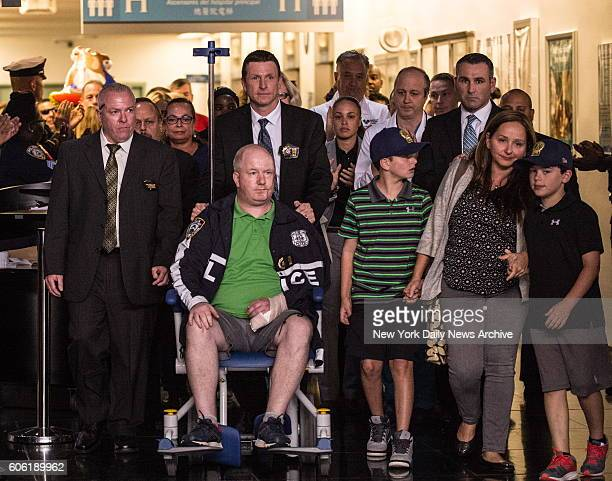 Officer Brian O'Donnell is pictured leaving Bellevue Hospital Friday September 16 2016 after getting hacked by a man with a meat cleaver a day earlier