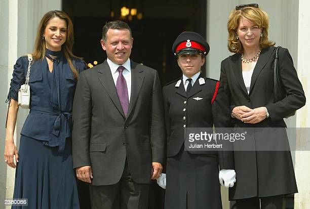 Officer Cadet Princess Iman of Jordan poses with her mother Queen Noor her brother King Abdullah and his wife Queen Rania after The 142nd Sovereign's...