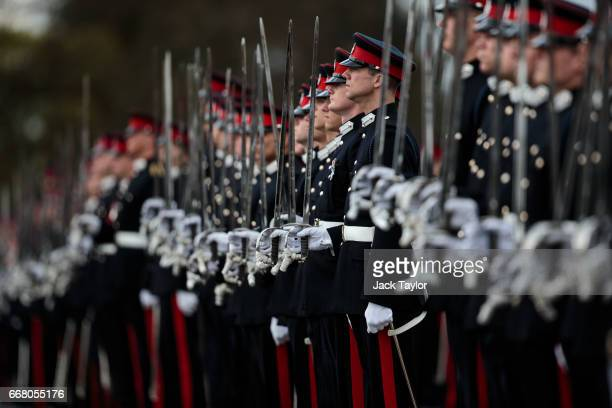 Officer Cadets take part in the Sovereign's Parade at Royal Military Academy Sandhurst on April 13 2017 in Camberley England British Prime Minister...