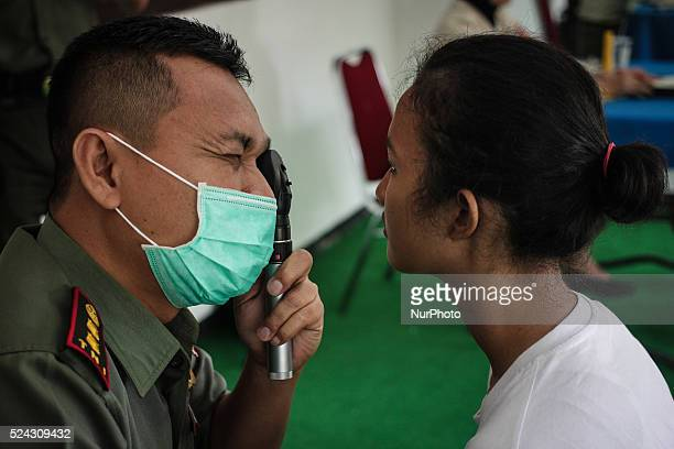 Officer conduct a eye examination of a candidate's career noncommissioned officer corps soldier army women at the Diponegoro Military Command...