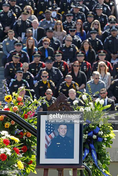 Officer David Hofer's portrait on stage at Pennington Field in Fort Worth Texas during a memorial service for the Euless Texas police officer on...