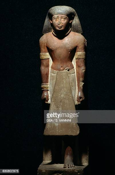 Officer decorated with the Necklace of honour 14401400 BC sandstone statue from Qau elKebir Egyptian civilisation New Kingdom Dynasty XVIII Luxor...