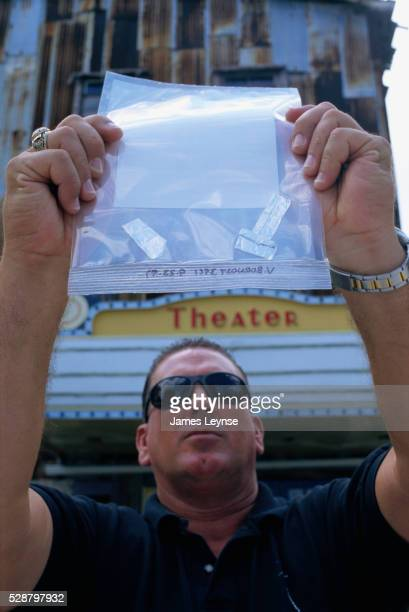 officer holding bags of drug ketamine - lieutenant stock pictures, royalty-free photos & images