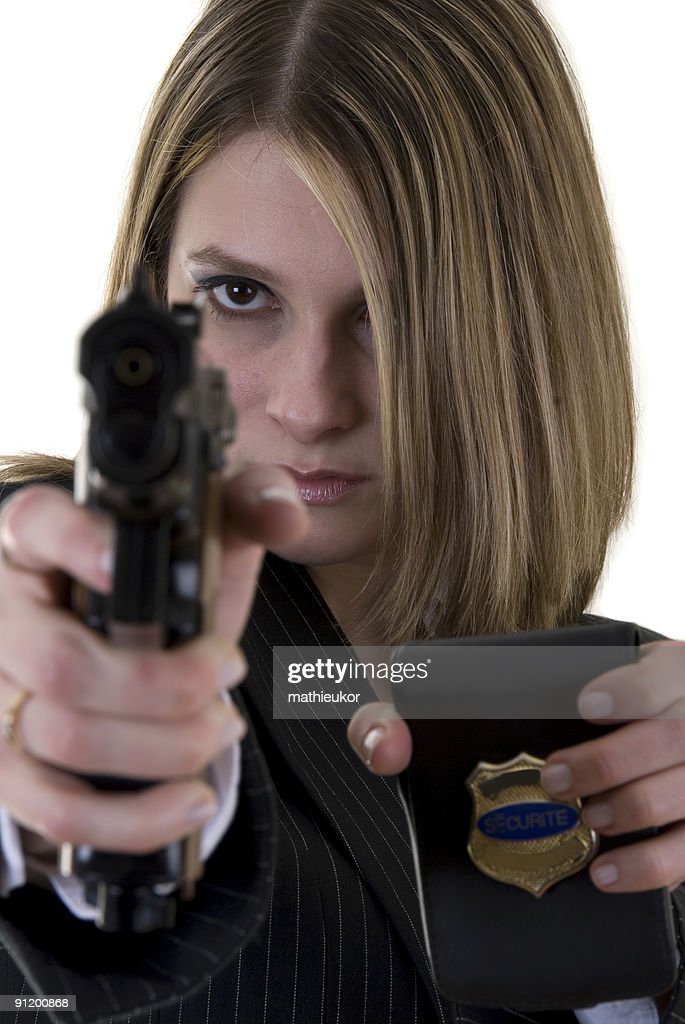 Officer in action : ready for shooting : Stock Photo