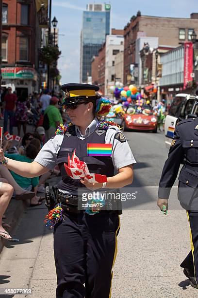 rcmp officer in pride parade - flag of nova scotia stock pictures, royalty-free photos & images