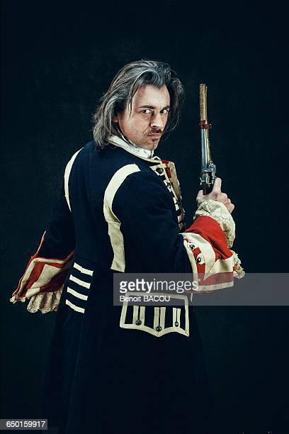 officer in uniform dragons, back, armed with a musket, is preparing for a duel - comedy film stock pictures, royalty-free photos & images