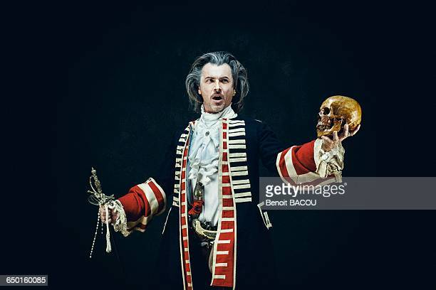 officer in uniform dragons, sings and holds a skull and a sword in his hands - period costume stock pictures, royalty-free photos & images