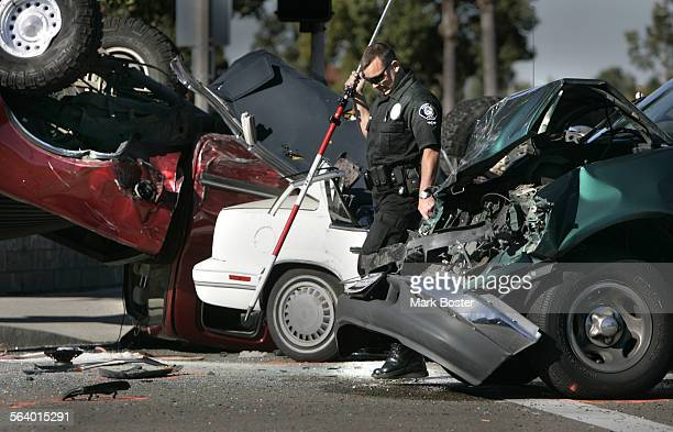 –Officer Jim Berwanger with the Major Collision Investigation Team from the Santa Ana Police Department helps to map out the intersection of Raitt...