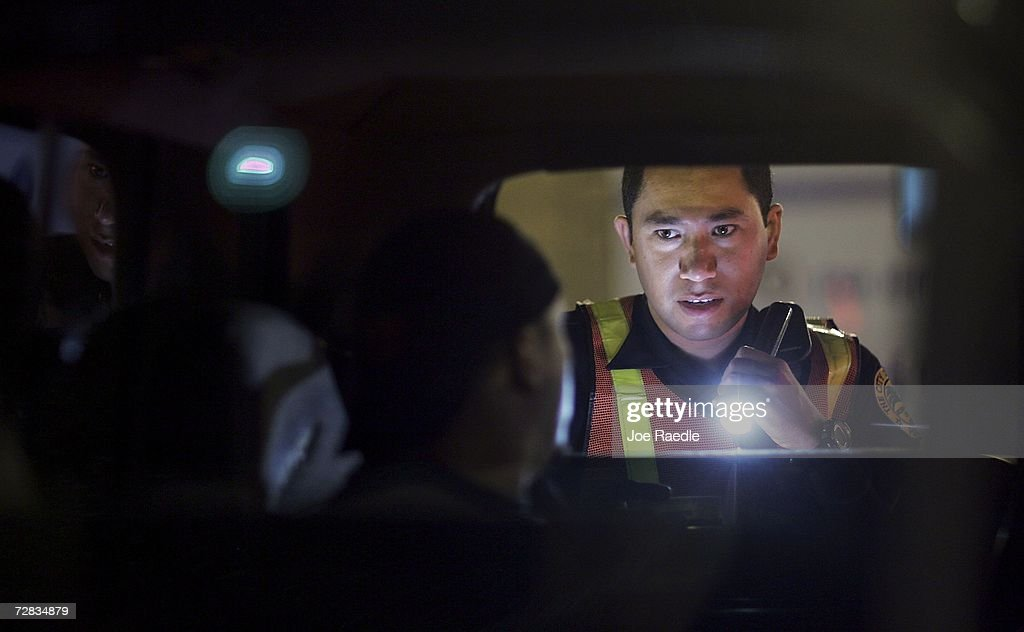 Officer L. Arias from the City of Miami police department questions a driver at a DUI checkpoint December 15, 2006 in Miami, Florida. The city of Miami, with the help of other police departments, will be conducting saturation patrols and setting up checkpoints during the holiday period looking to apprehend drivers for impaired driving and other traffic violations.
