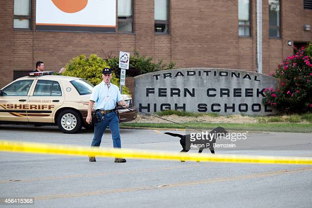 K9 officer leaves Fern Creek High School after a shooting incident September 30 2014 in Louisville Kentucky Police say a male suspect was taken into...