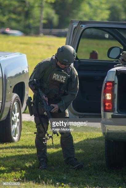 SWAT officer loads his weapon outside Noblesville West Middle School after a shooting at the school on May 25 2018 in Noblesville Indiana One teacher...
