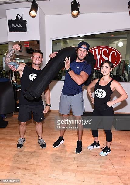 NYPD officer Mike Counihan Shawn Booth and NYSC trainer Alyssa Exposito celebrate First Responders Appreciation Month at New York Sports Clubs at New...