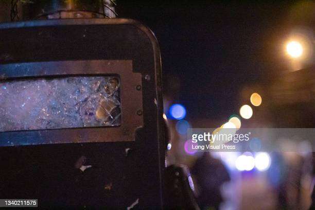 Officer of Colombia's riot police squadron with the window of his bulletproof shield cracked protect the Villa Luz CAI police station were police...