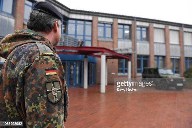 A officer of the German Bundeswehr stands in front the Bundeswehr infantry training facility on December 6 2018 in Munster Germany Germany is...
