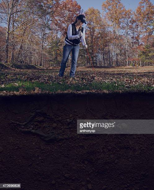 csi officer probing for remains crime scene - antiquities stock pictures, royalty-free photos & images