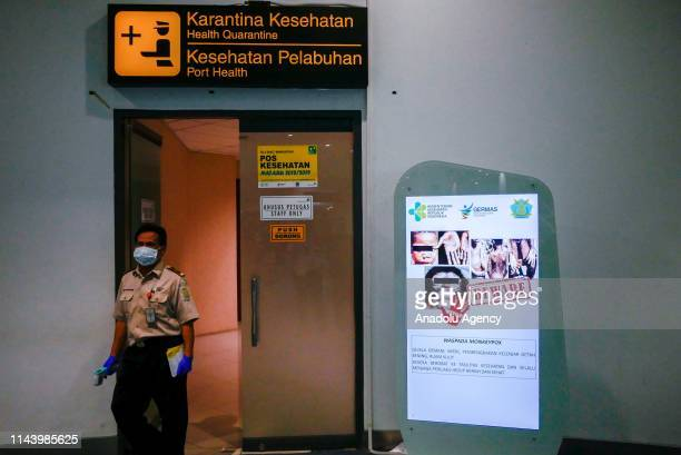 Officer ready to detect a monkeypox virus on arriving passengers at SoekarnoHatta International Airport in Tangerang near Jakarta Indonesia on May 15...