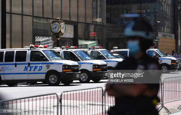 Officer stands guard on 5th Avenue at Trump Tower during a protest against police brutality and racial inequality in the aftermath over the death of...