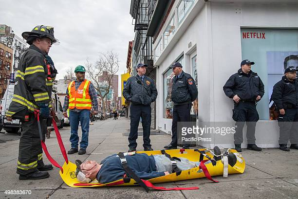 FDNY officer stands next to a simulated gunshot victim who he has removed from the danger area NYC first responders from the NYPD and FDNY staged a...