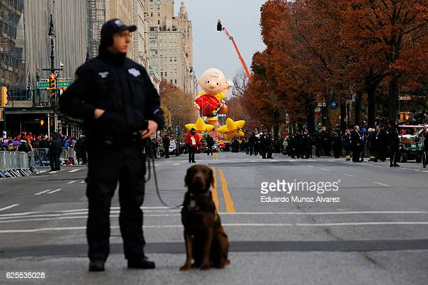 NYPD officer stands stand guard with his dog during the 90th Macy's Annual Thanksgiving Day Parade on November 24 2016 in New York City Security was...