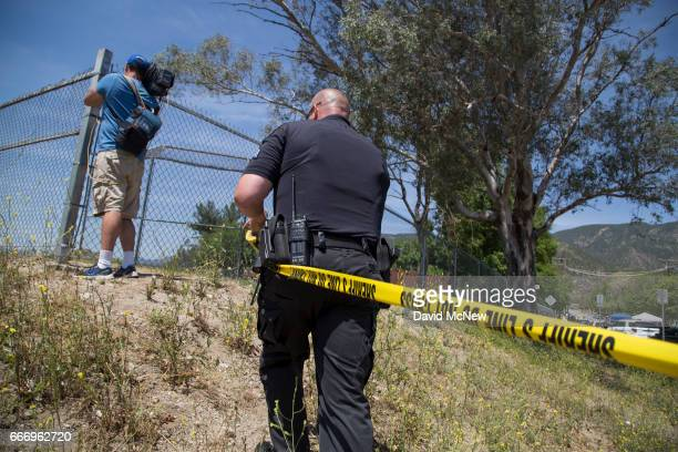 A officer tapes off access outside North Park Elementary School following a shooting on campus on April 10 2017 in San Bernardino California Two...