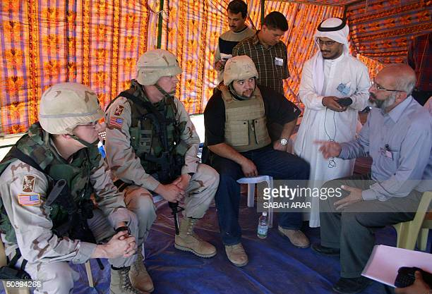 US officer Williams sits in negotiations with Dr Alaa Makki a senior member of the Islamic Party in a tent setup outside the Abu Ghraib prison west...
