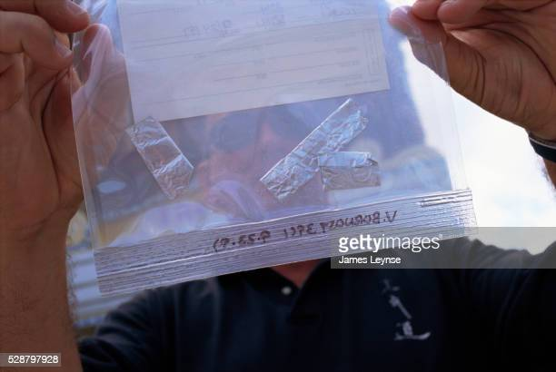 officer with samples of drug ketamine - lieutenant stock pictures, royalty-free photos & images