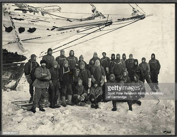 Officers and crew of the 'Endurance' the shore party group pose under the bow of the 'Endurance' at Weddell Sea Base during the Imperial...
