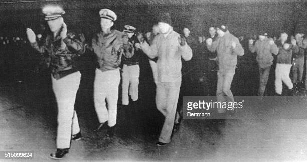 Officers and crew of the United States Navy ship USS Pueblo being led away after being captured by North Korean forces in international waters in the...