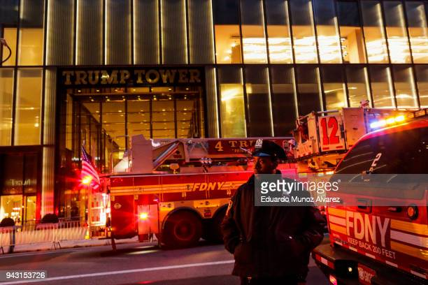 NYPD officers and first responders assess the scene of a fire at Trump Tower on April 7 2018 in New York City One person has reportedly died and four...
