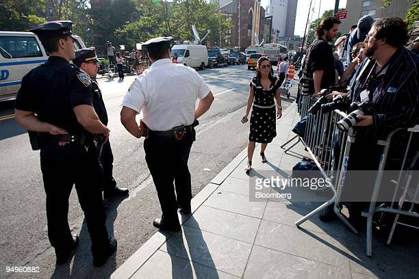 Officers and members of the media stand outside federal court in New York US on Monday June 29 2009 Bernard Madoff founder of Bernard L Madoff...