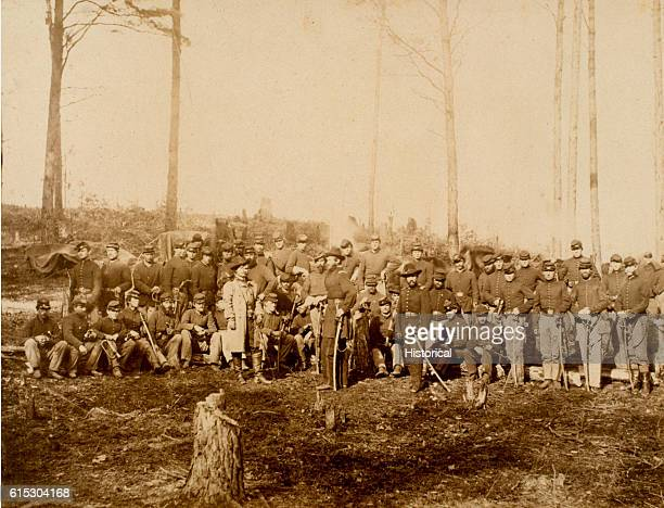 Officers and men of the 1st United States Cavalry pose after the Battle of Five Forks General George Armstrong Custer stands at front | Location near...
