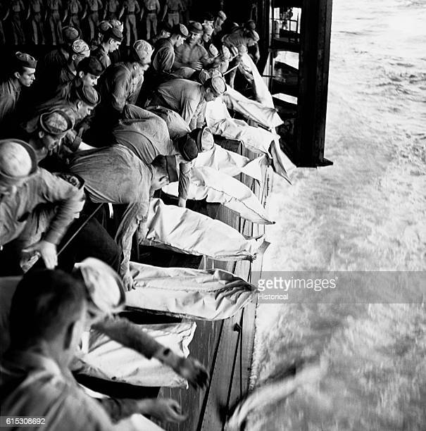 Officers and men of the USS Intrepid killed during the battle for Leyte Gulf in the Philippines receive honorable burial at sea on November 26 1944 |...