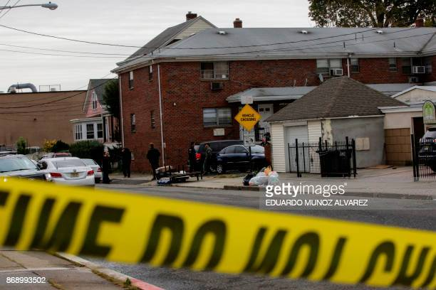 FBI officers and New Jersey police officers walk outside of suspect Sayfullo Saipov's apartment on November 1 in Paterson New Jersey A pickup driver...