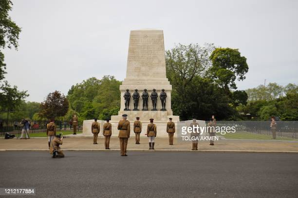 Officers and soldiers of Household Division observe social distancing as they take part in a 2 minute silence and wreathlaying ceremony to mark the...