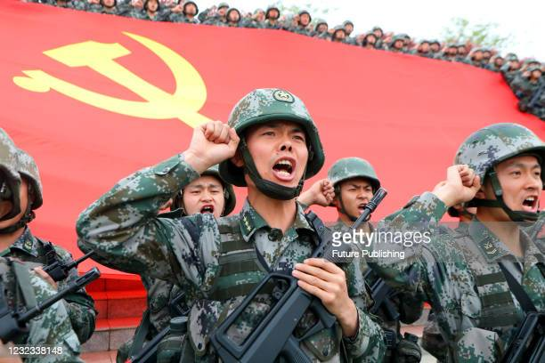 Officers and soldiers review their vows of joining the Communist Party of China in Luoyang, central China's Henan Province, April 13, 2021.