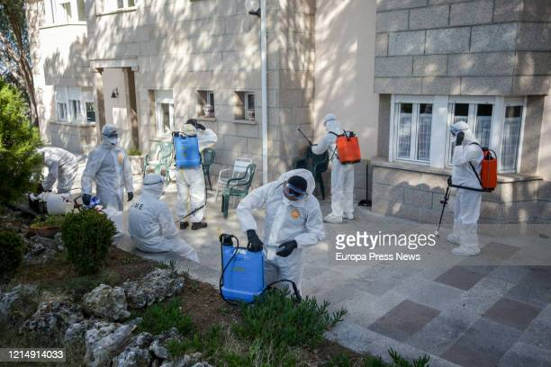 Officers are seen preparing to disinfect the nursing home San Carlos del Bosque at the town of Villaviciosa de Odon, one of the hundreds of nursing...