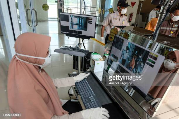 Officers are seen using a face mask to prevent Coronavirus at Sultan Syarif Kasim II airport in Pekanbaru Riau Province Indonesia on January 23 2020...