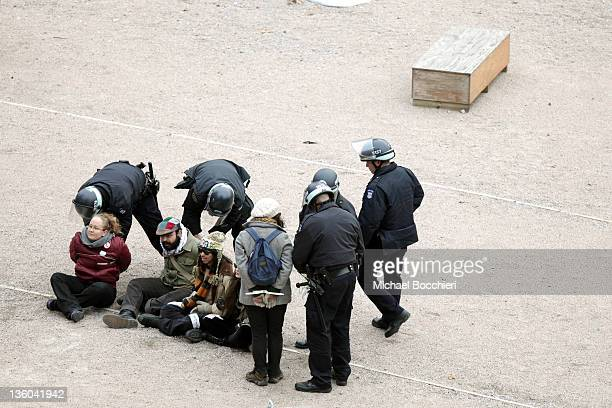 Officers arrest activists after they gained entrance to a private park owned by Trinity Church next to Duarte Square at Sixth Avenue and Canal Street...