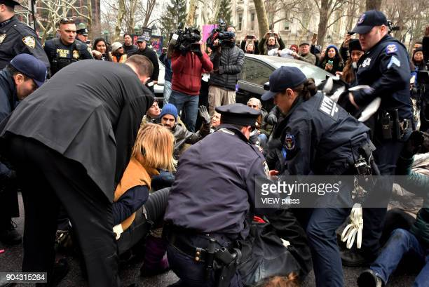 Officers arrest protestors as an ambulance carrying immigration rights activist Ravi Ragbir the executive director of the New Sanctuary Coalition...