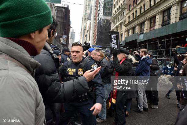 Officers Blocks protestors as an ambulance carrying immigration rights activist Ravi Ragbir the executive director of the New Sanctuary Coalition...