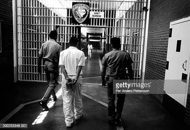 Officers bring an unidentified prisoner to his cell on April 15 1997 at Ellis Unit in Huntsville Texas USA Texas has about 450 prisoners on death row...