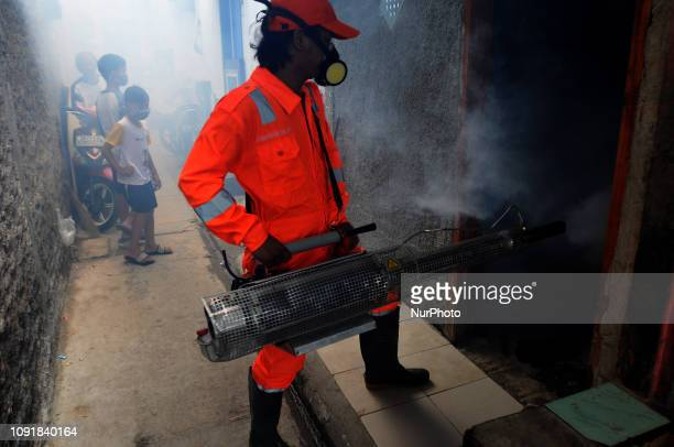 Officers carried out fumigation in the slum areas of the population and narrow alleys to prevent dengue fever diseases and viruses caused by Aedes...