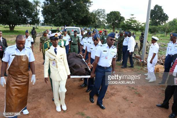 Officers carries the remains of the two Air Force pilots killed in a fighter jet crash in Abuja on September 28 2018 during their funerals Nigeria's...