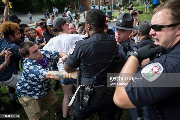 Officers clash with counter protestors after the Ku Klux Klan staged a protest on July 8 2017 in Charlottesville Virginia The KKK is protesting the...