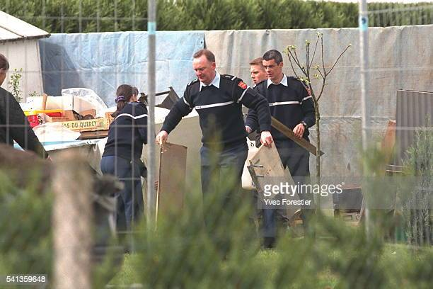 Officers clear the spot in the garden where JY Morel said he buried Marylene Roussey 16